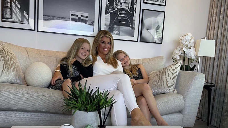 Jeri and her two daughters in their home